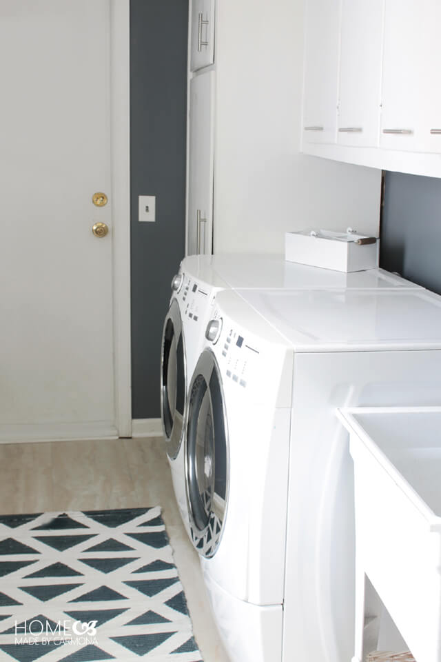 Laundry room with lots of storage cabinets
