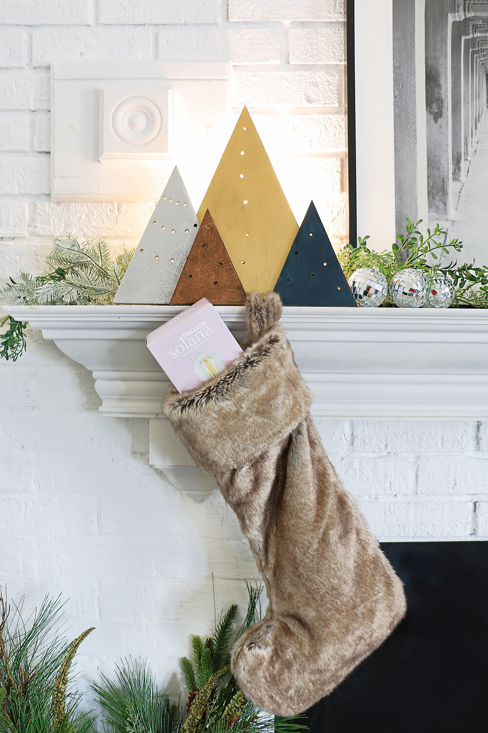 Holiday light with stocking on mantel
