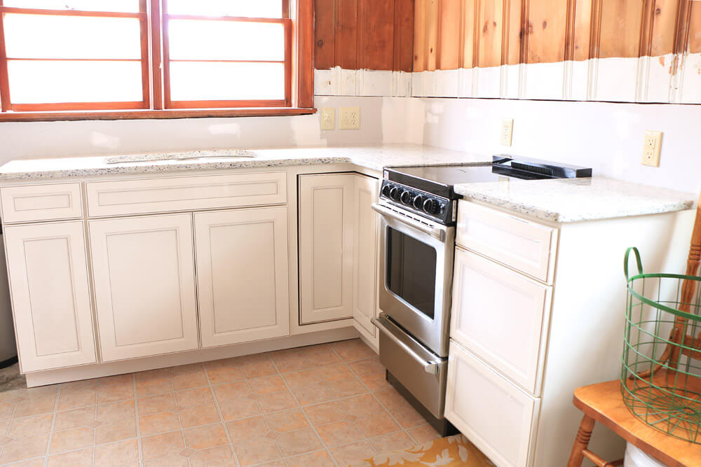 Cottage Kitchen Renovation - cabinets and oven