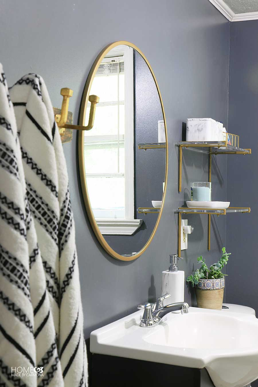 Bathroom mirror sink towels and shelves