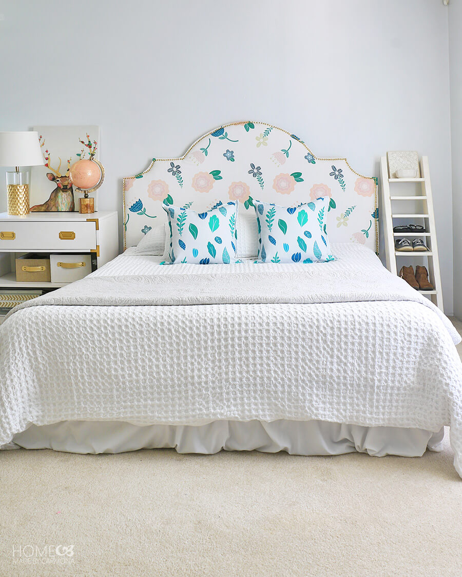 Bedroom with nailhead headboard