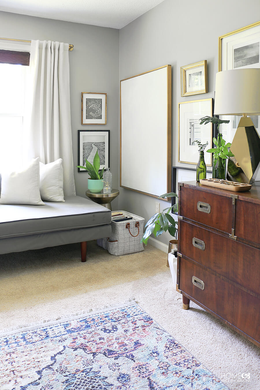 Bedroom-with-gallery-wall-and-chaise