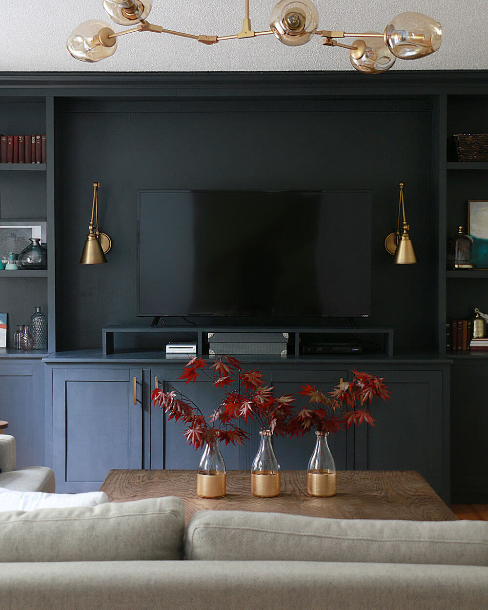 TV-built-ins-with-brass-sconce