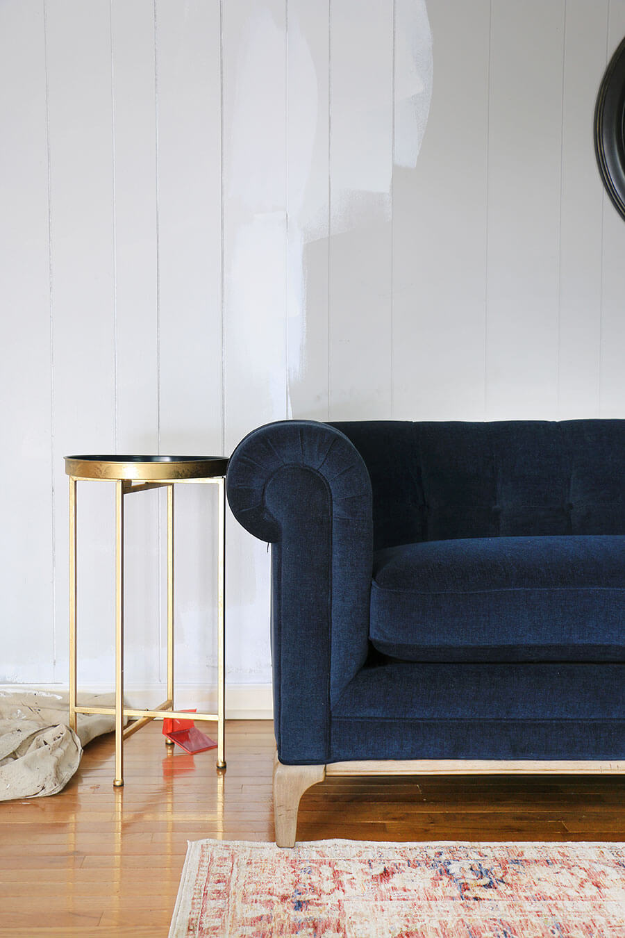 Blue sofa + gold accent tables