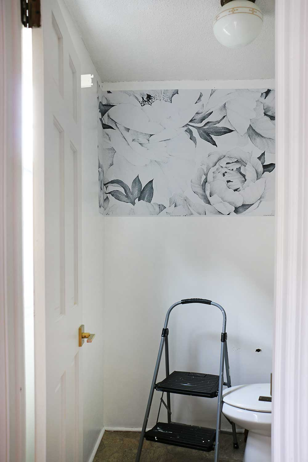 Wallpaper-going-up-in-a-powder-room