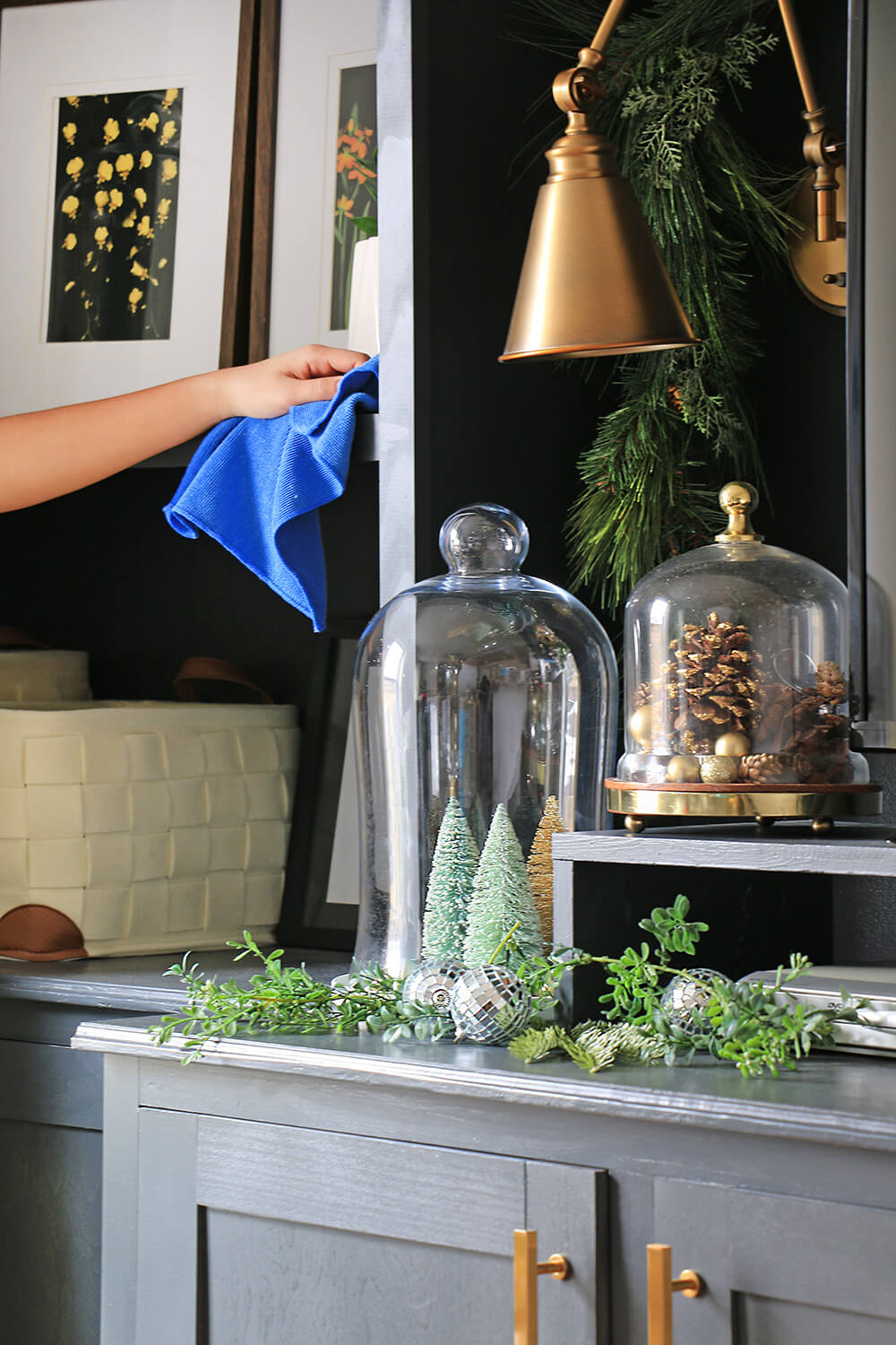 Cleaning-a-shelf-with-holiday-decor